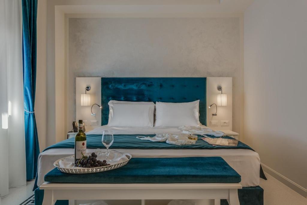 Letto o letti in una camera di Battistero Residenza d'Epoca