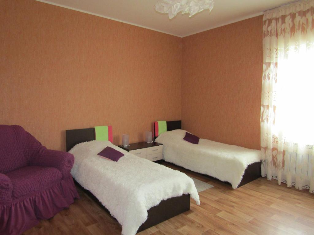 Кровать или кровати в номере Отель Сказка в Толмачево
