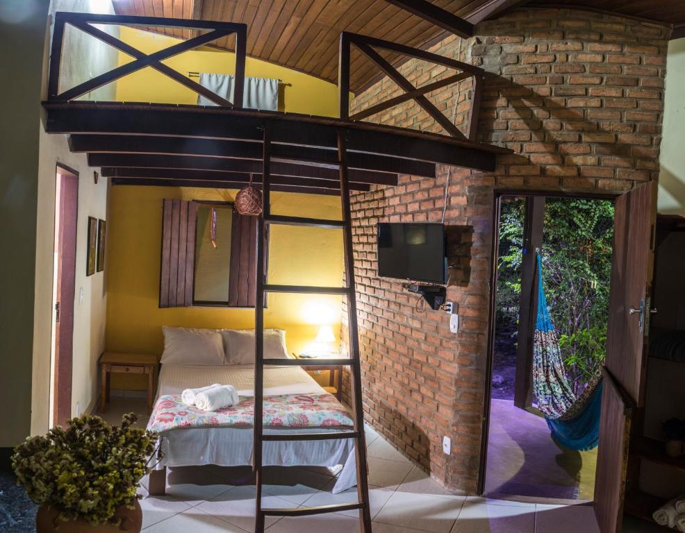A bunk bed or bunk beds in a room at Villa Justen Pousada