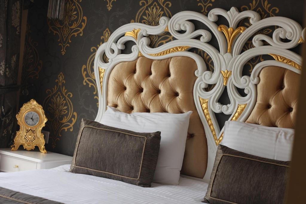 Кровать или кровати в номере Gulhane Garden Hotel