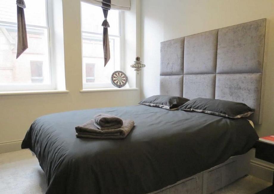 Vuode tai vuoteita majoituspaikassa Trip & Hostel