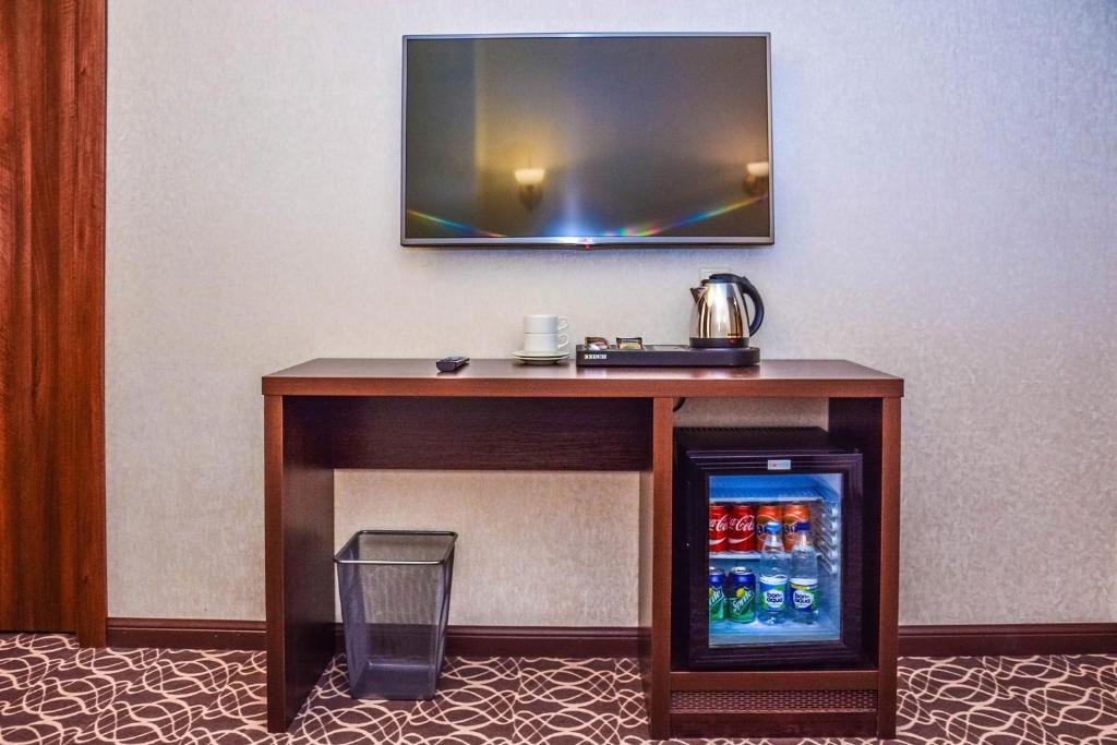 Телевизор и/или развлекательный центр в Отель Раймонд