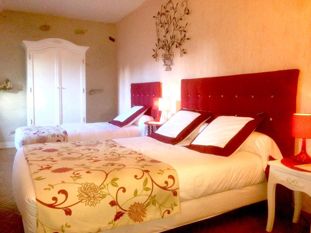 Un ou plusieurs lits dans un hébergement de l'établissement Chambres d'Hôtes L'Orée des Vignes