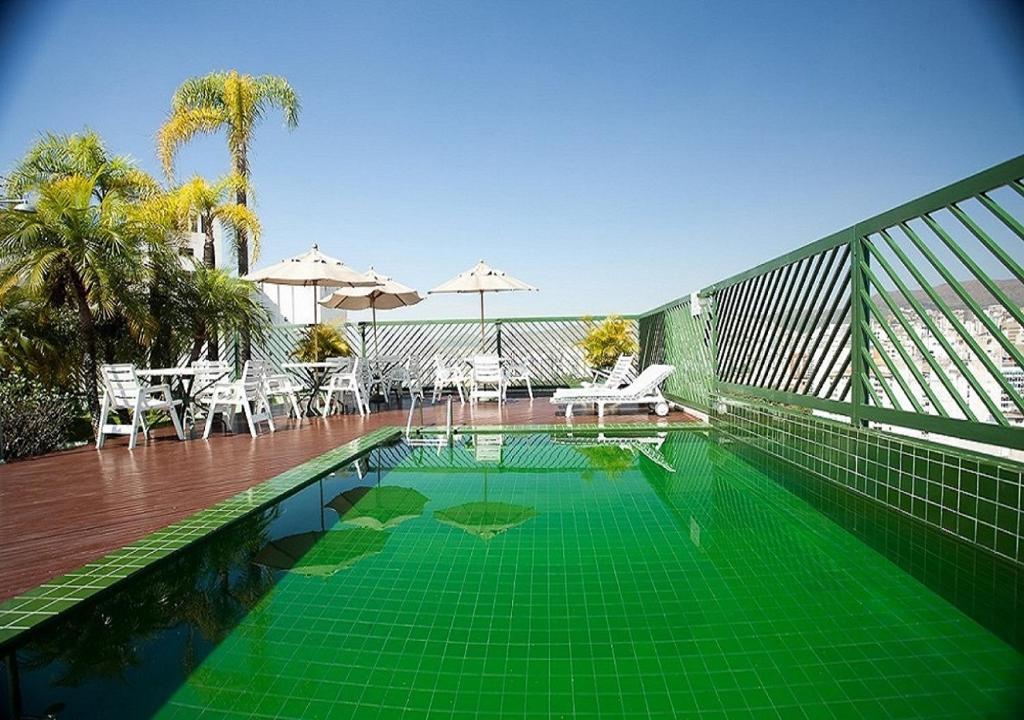 The swimming pool at or near Dayrell Hotel e Centro De Convenções