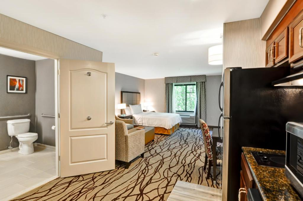 A television and/or entertainment center at Homewood Suites by Hilton Cambridge-Arlington