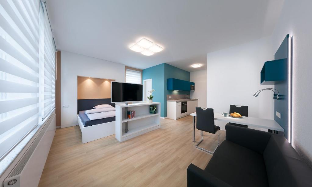 Ein Sitzbereich in der Unterkunft Apartments Drei Morgen