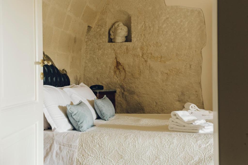 A bed or beds in a room at Casastella