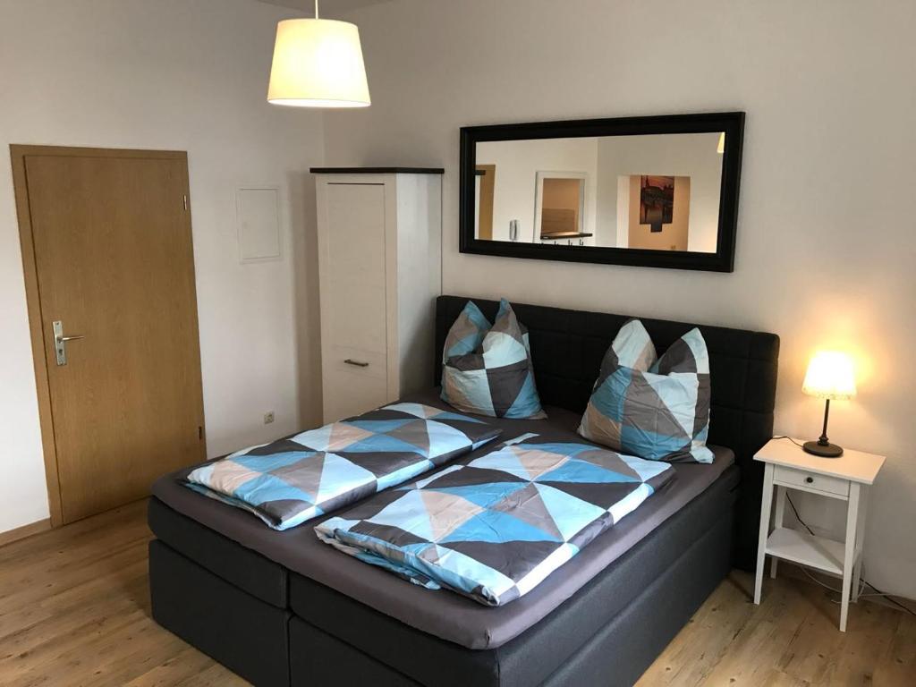 Ein Bett oder Betten in einem Zimmer der Unterkunft Pension Dresdener Berge
