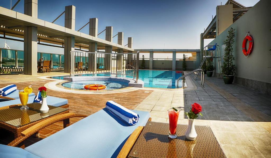 The swimming pool at or near Rose Park Hotel Al Barsha