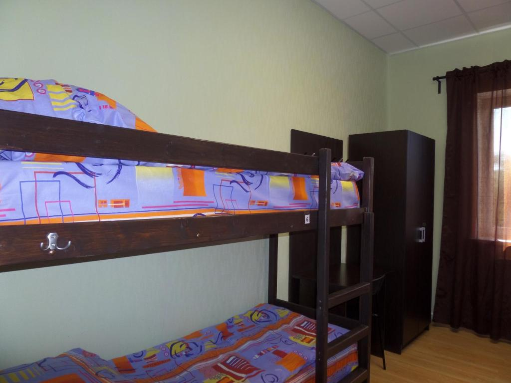 A bunk bed or bunk beds in a room at Hostel XO