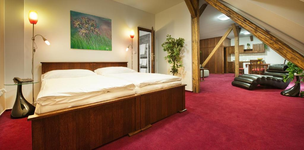 Кровать или кровати в номере Brioni Suites