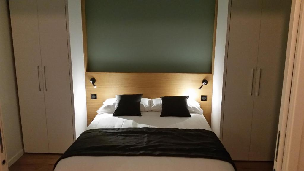 Ein Bett oder Betten in einem Zimmer der Unterkunft Hotel Résidence Montebello