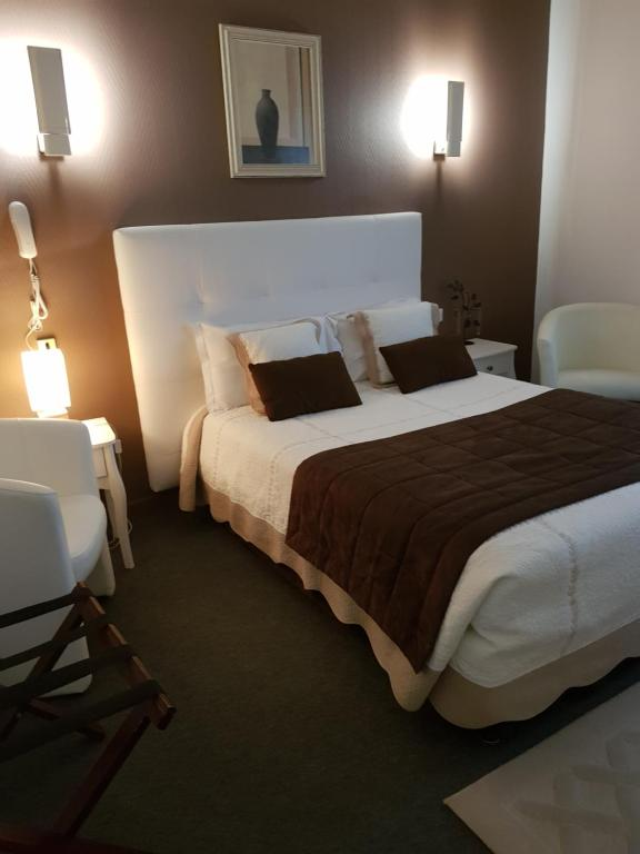 A bed or beds in a room at Hotel Christina - Contact Hotel