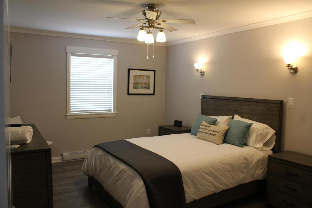 A bed or beds in a room at Cape Breton Villas