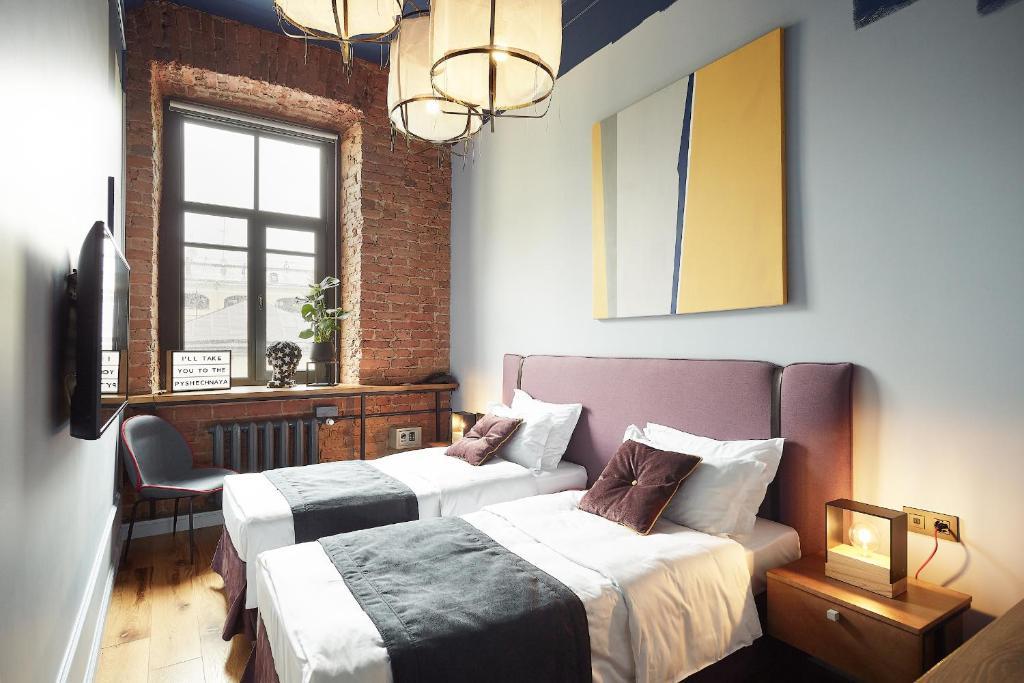 Кровать или кровати в номере WYNWOOD Hotel