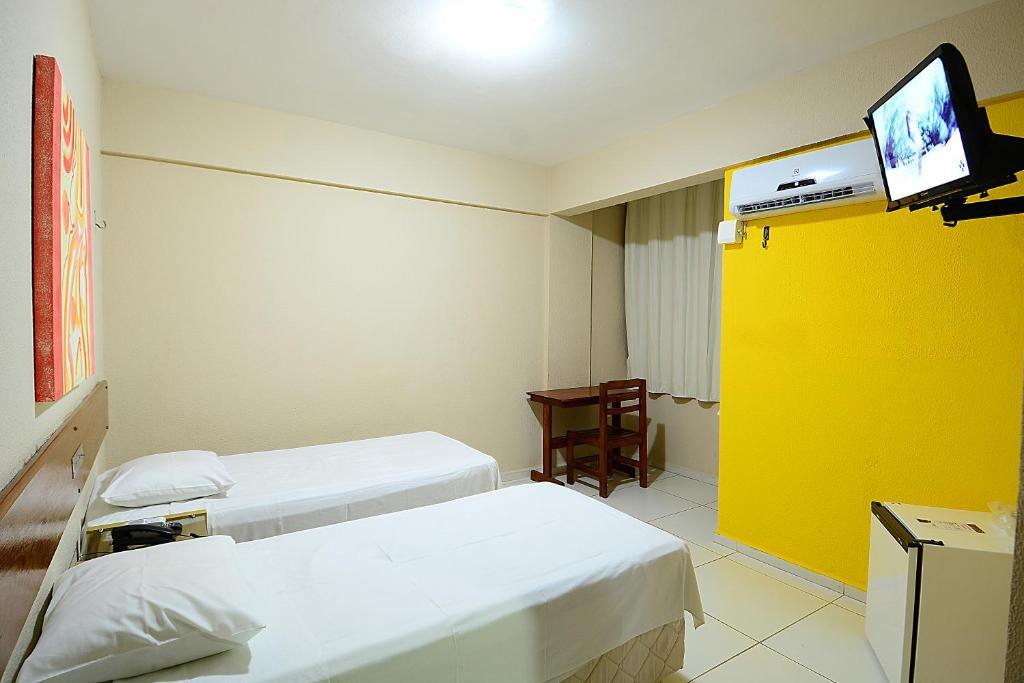 Cama ou camas em um quarto em Hotel Imperial