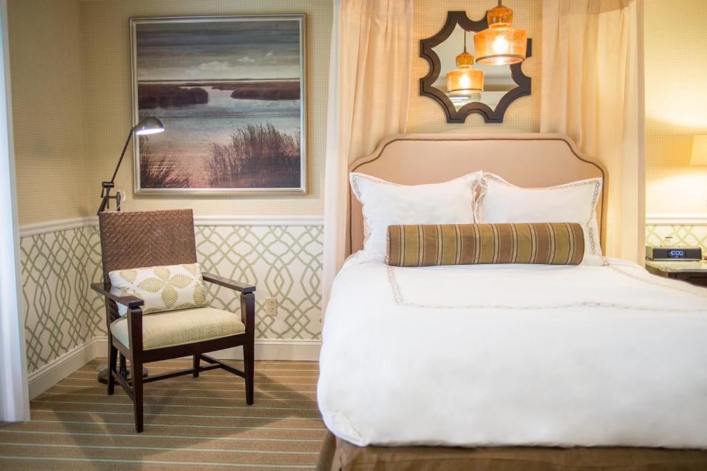 A bed or beds in a room at The Mansion at Ocean Edge Resort & Golf Club