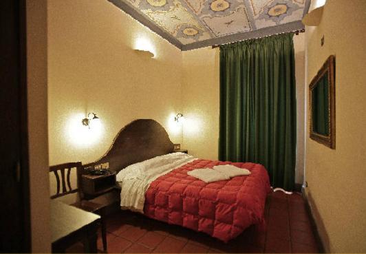 Cama o camas de una habitación en Hotel Panda