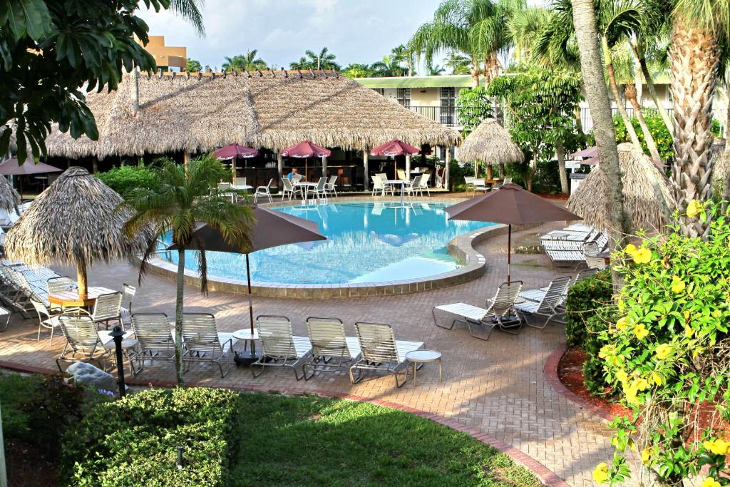 A view of the pool at Gulfcoast Inn Naples or nearby
