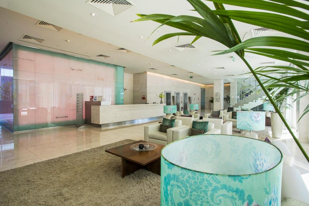The lobby or reception area at Olissippo Oriente