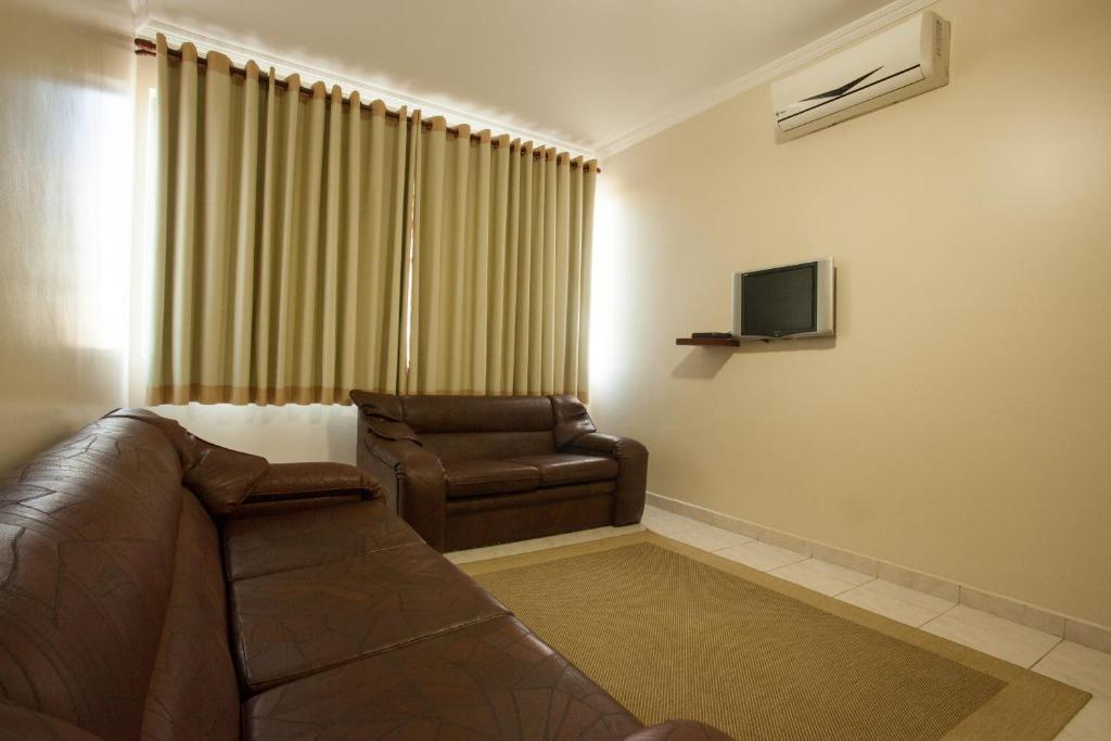 Uma área de estar em Carina Flat Santos by Atlantica Hotels