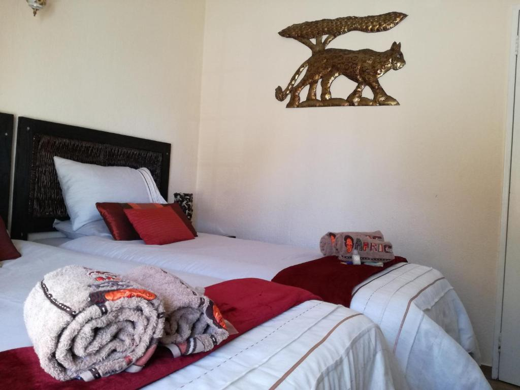 A bed or beds in a room at All over Africa Guest house