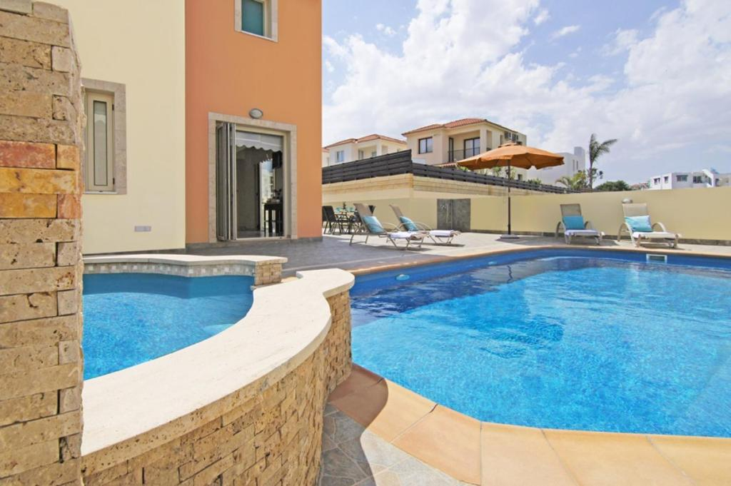 The swimming pool at or near Zelia Villa