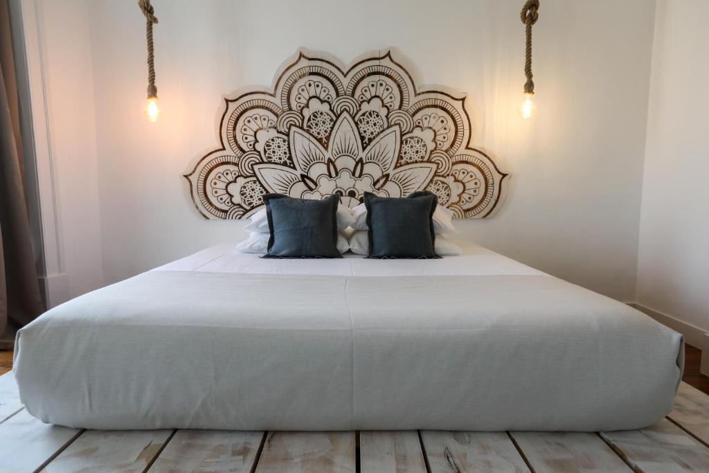 Cama o camas de una habitación en The Saints Suites
