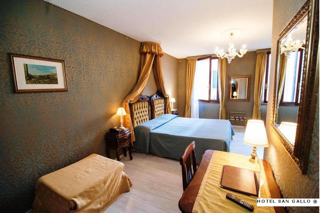 Letto o letti in una camera di Hotel San Gallo