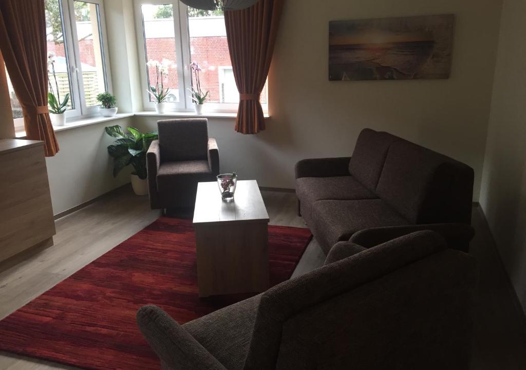 Ein Sitzbereich in der Unterkunft Ferienhaus Engelsby