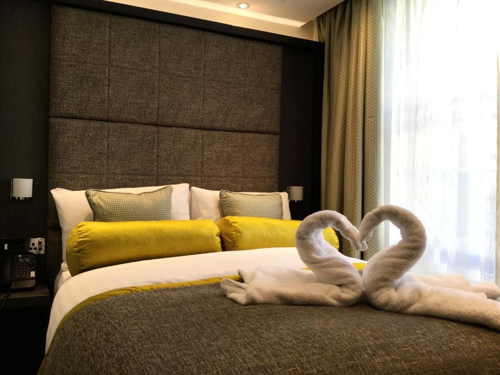 Ein Bett oder Betten in einem Zimmer der Unterkunft Mornington Hotel London Victoria