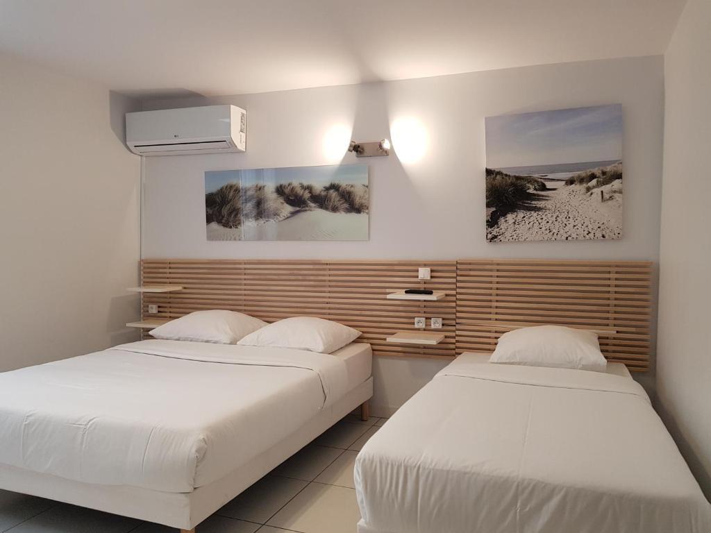 Un ou plusieurs lits dans un hébergement de l'établissement Hotel Majestic