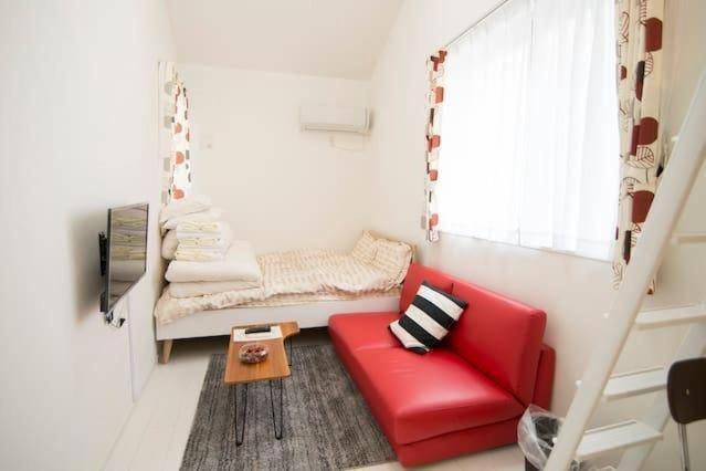 A seating area at Fttakuya Apartment in Shinjuku 206