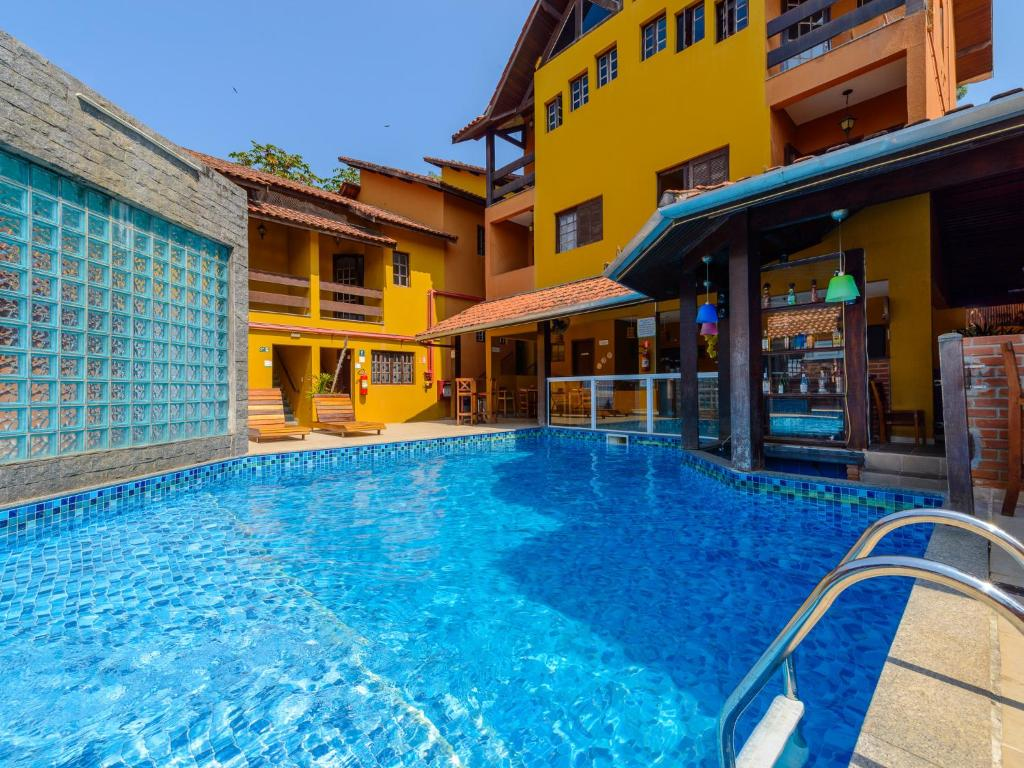 The swimming pool at or near Pousada Morada do Arquiteto - Unidade Martin de Sá