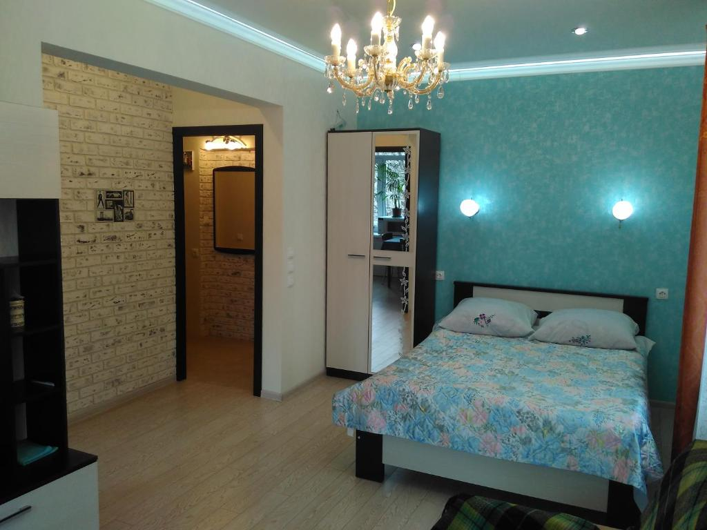 Кровать или кровати в номере Apartment on Prospekt Lenina 10