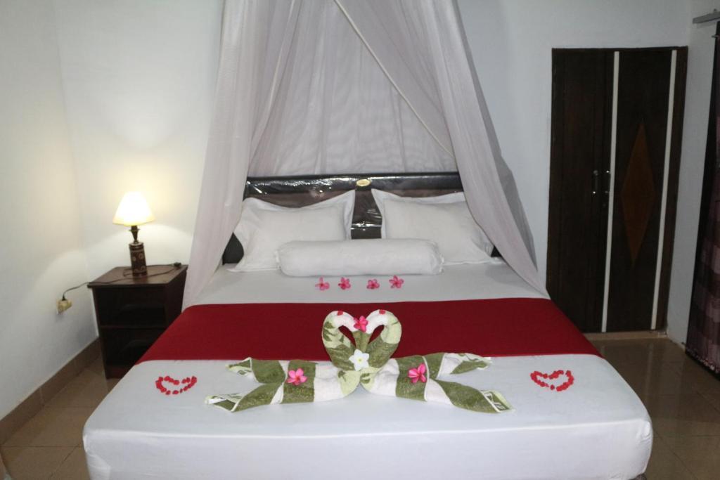Posteľ alebo postele v izbe v ubytovaní Yayan