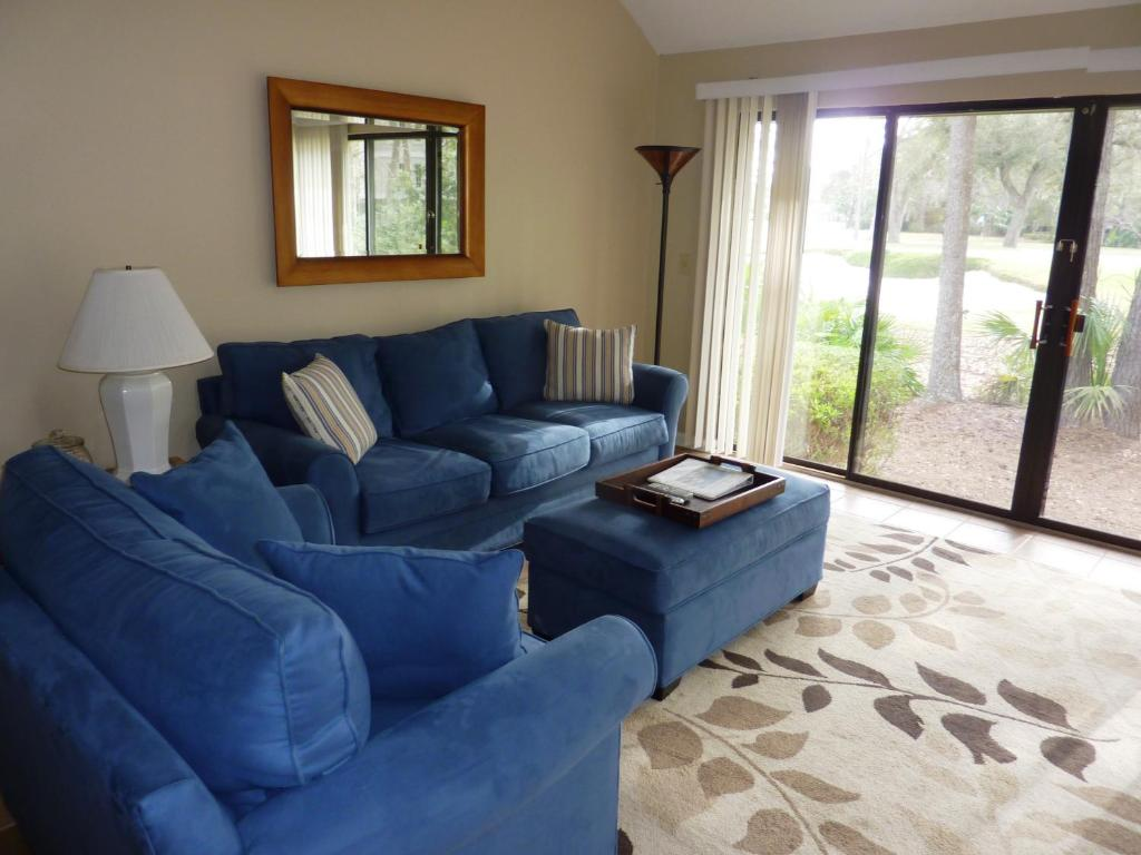 A seating area at Seapines 600 Wildwood Spa Villas