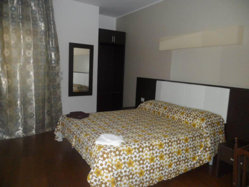 La Terrazza sul Boscoにあるベッド
