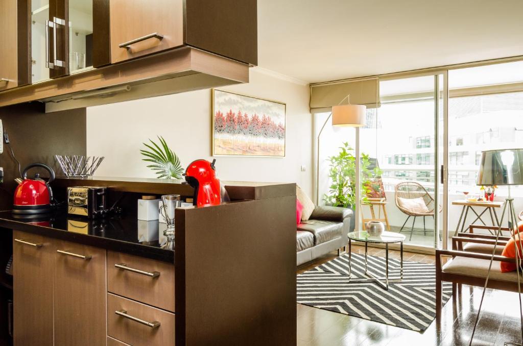A cozinha ou cozinha compacta de Departamento Amoblado Las Condes
