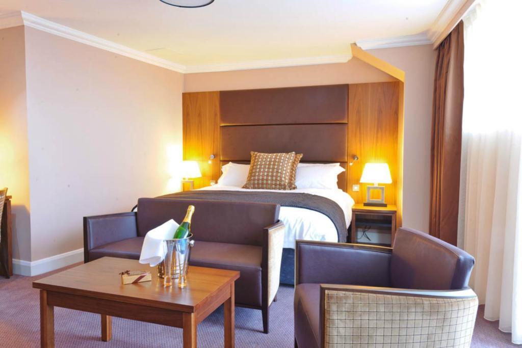 Кровать или кровати в номере Rox Hotel