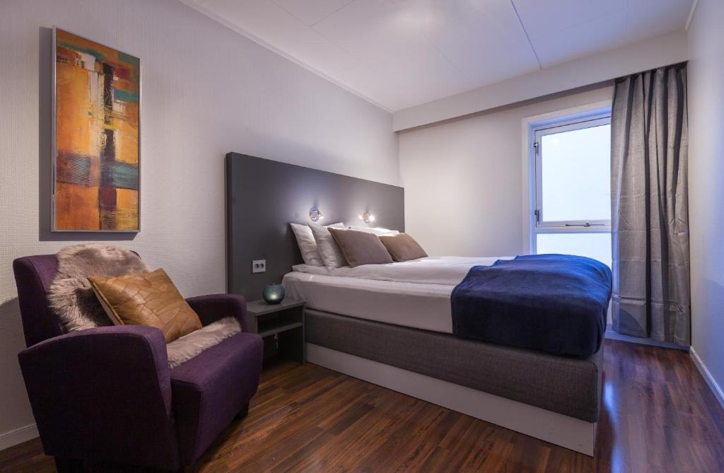 A bed or beds in a room at Enter Viking Hotel