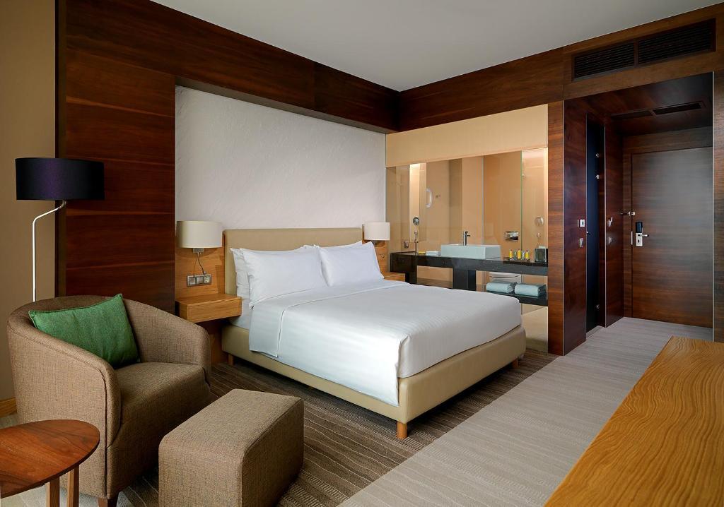 Кровать или кровати в номере Voronezh Marriott
