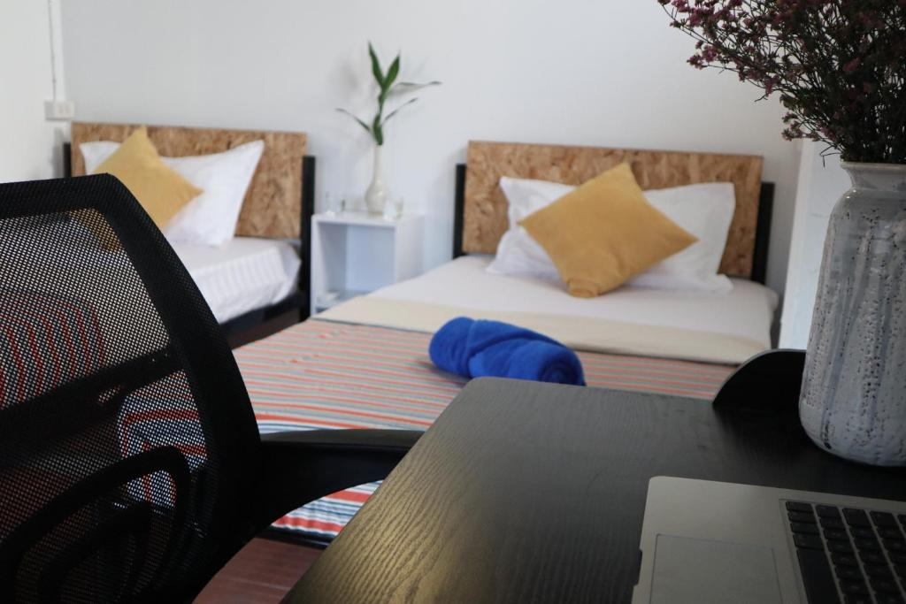 A bed or beds in a room at IN THE CITY Co-Living & Co-Working Space