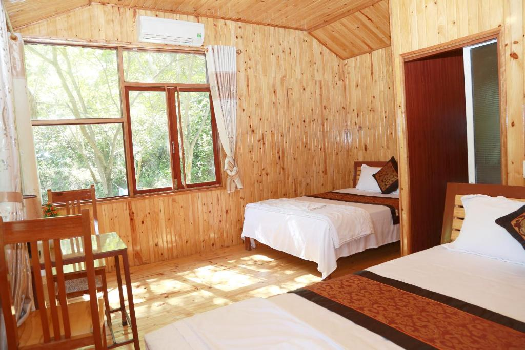 A bed or beds in a room at Phong Nha Midtown Hotel