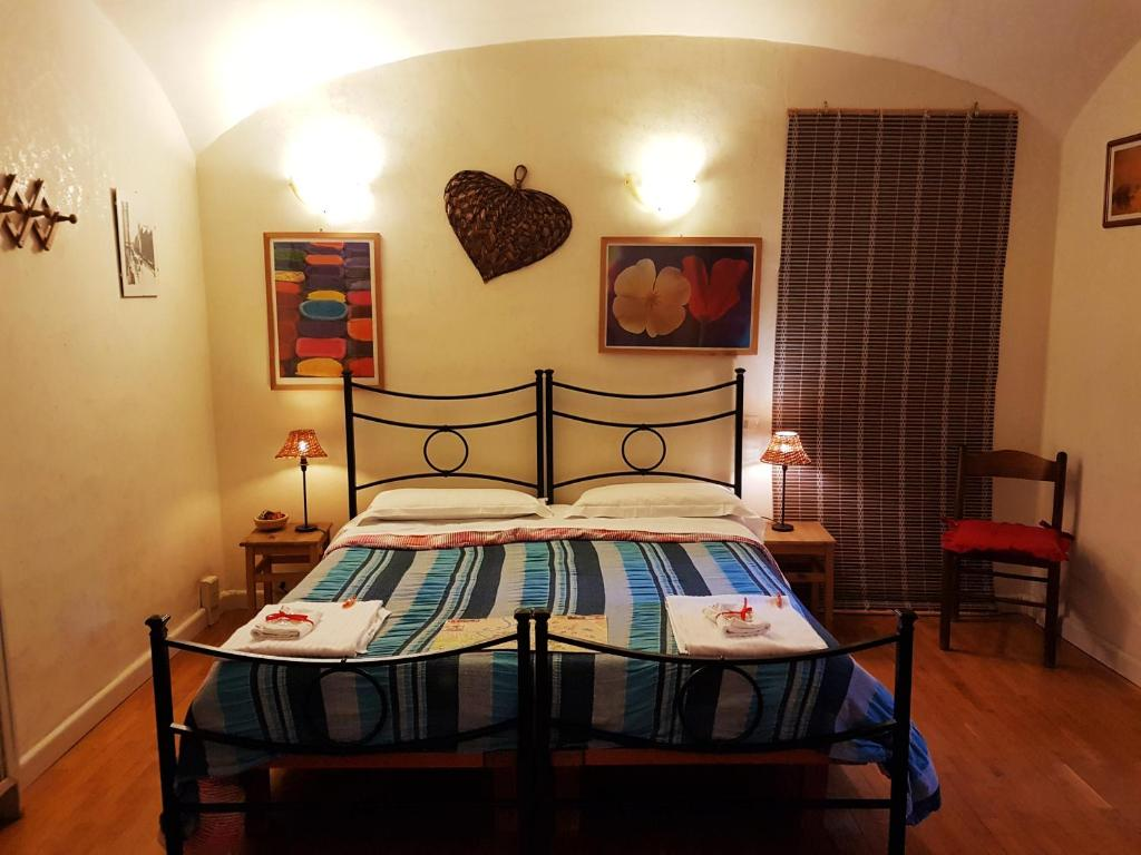 A bed or beds in a room at L'Incanto Di Roma