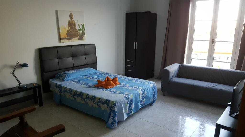 A bed or beds in a room at Rooms Tampico