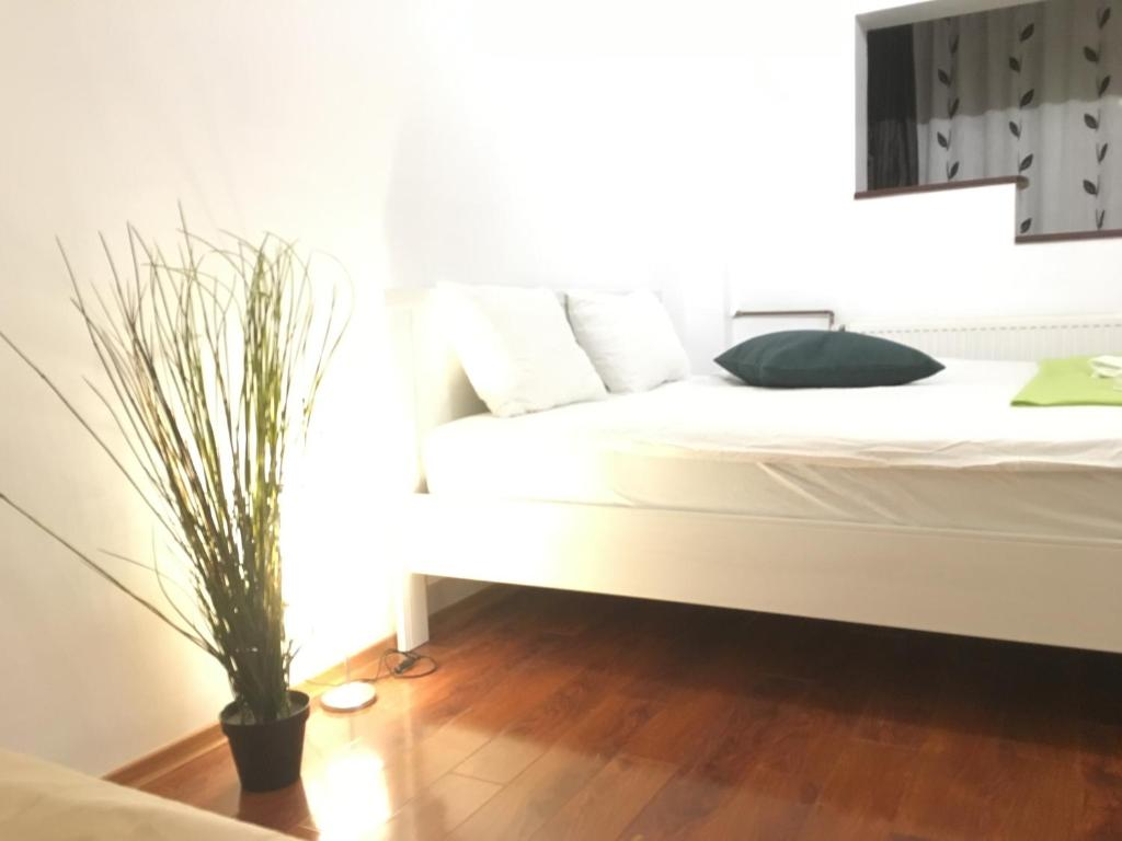 A bed or beds in a room at New Green Apartment Studio 1