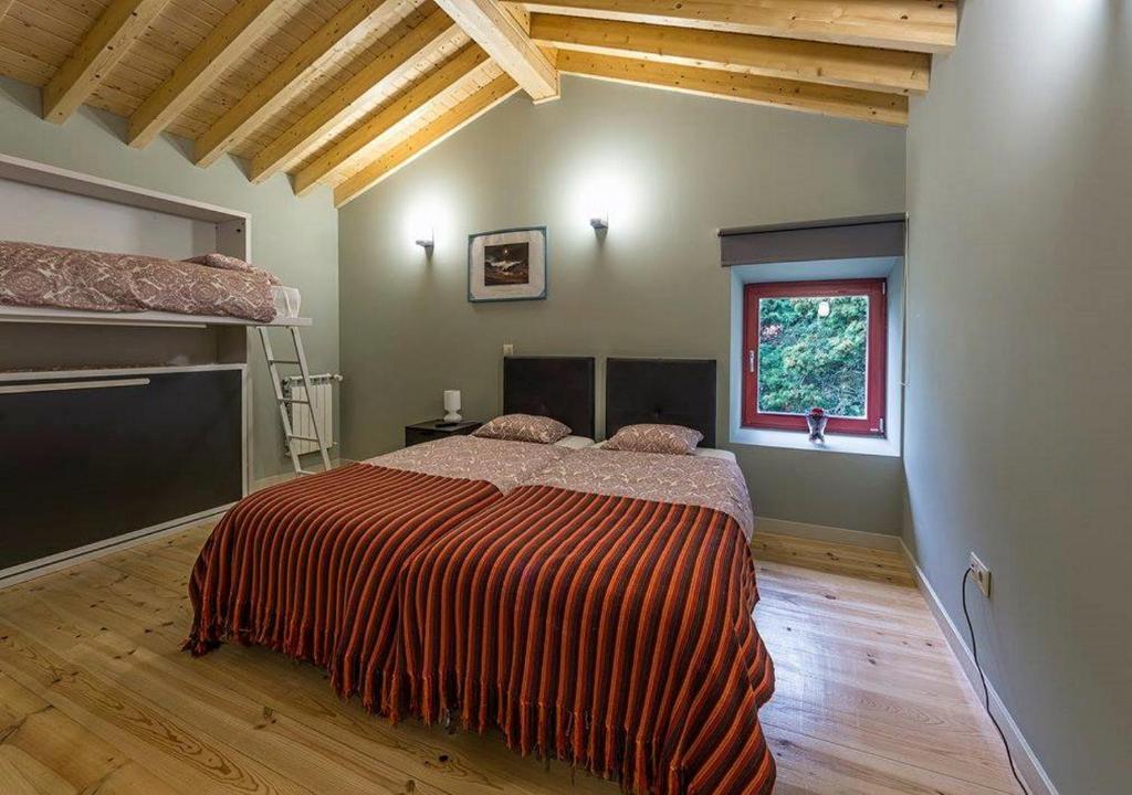 A bed or beds in a room at Pousada de Mafra - Palácio dos Marqueses