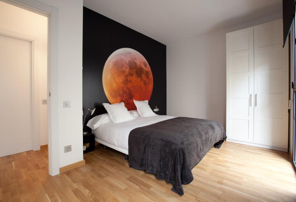 Ein Bett oder Betten in einem Zimmer der Unterkunft Blackandwhitehome Gracia