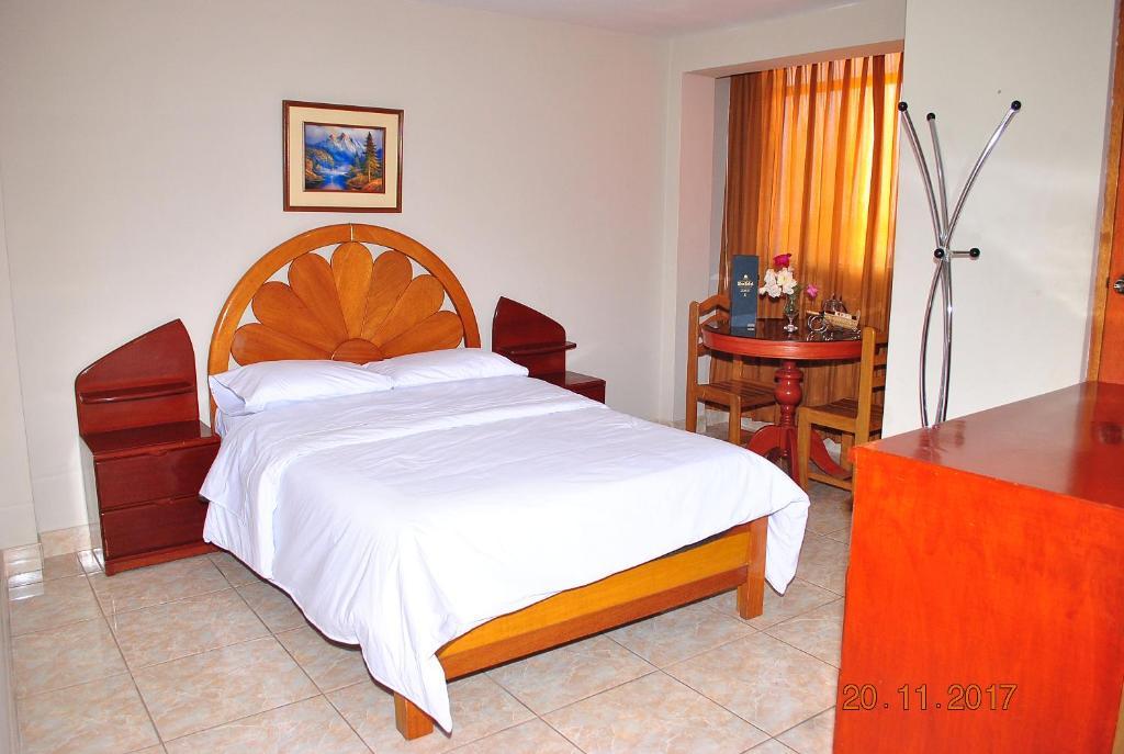 מיטה או מיטות בחדר ב-Hostal Don Reymundo